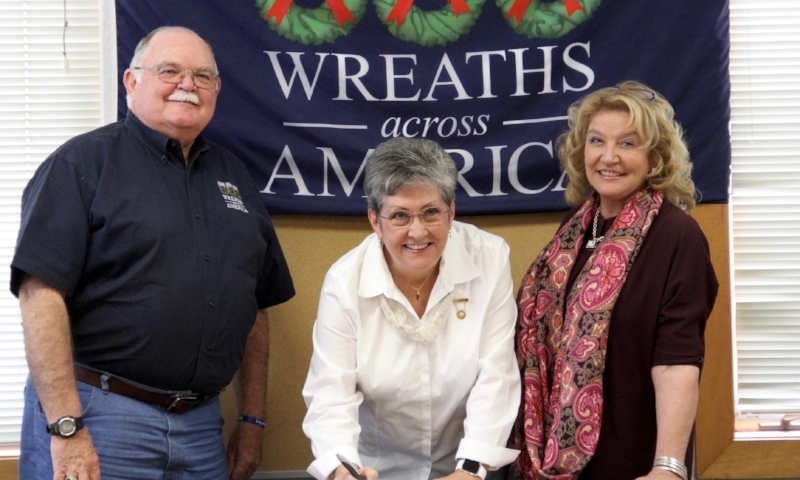 On Oct. 20, 2016, at the Wreaths Across America National Headquarters in Columbia Falls, Maine, American Gold Star Mothers entered into a formal partnership with WAA, aligning the groups' similar missions. Pictured at the signing is (L-R) Wayne Hanson, WAA Chairman of the Board; Candy Martin, National President, AGSM; and Karen Worcester, WAA Executive Director.