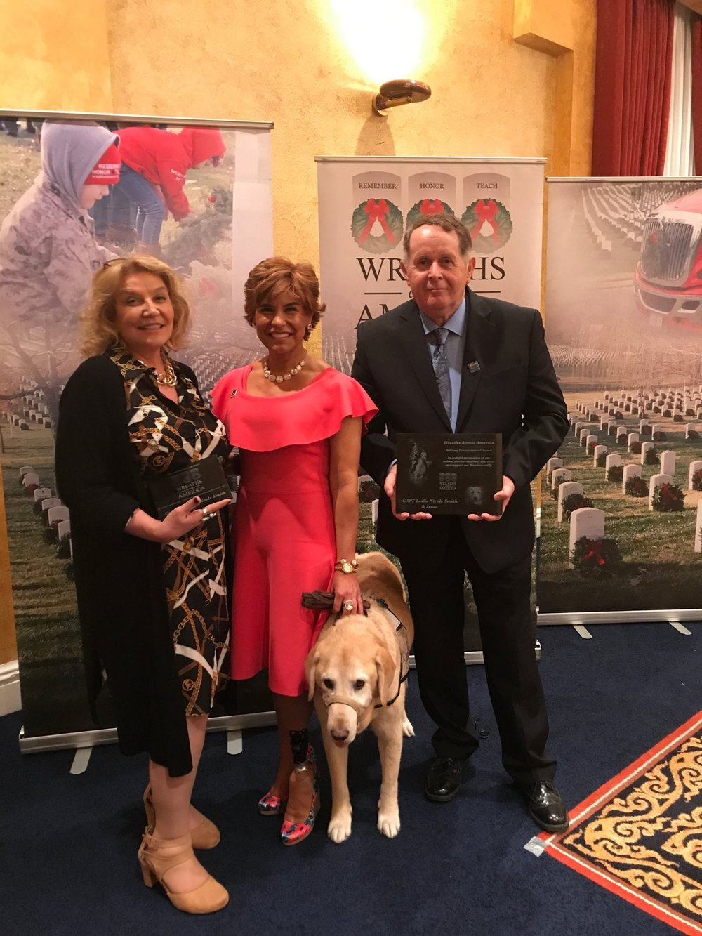 Captain Leslie Smith and her service dog Issac pictured here with Karen and Morrill Worcester during WAA-UMA awards and recognition ceremony.