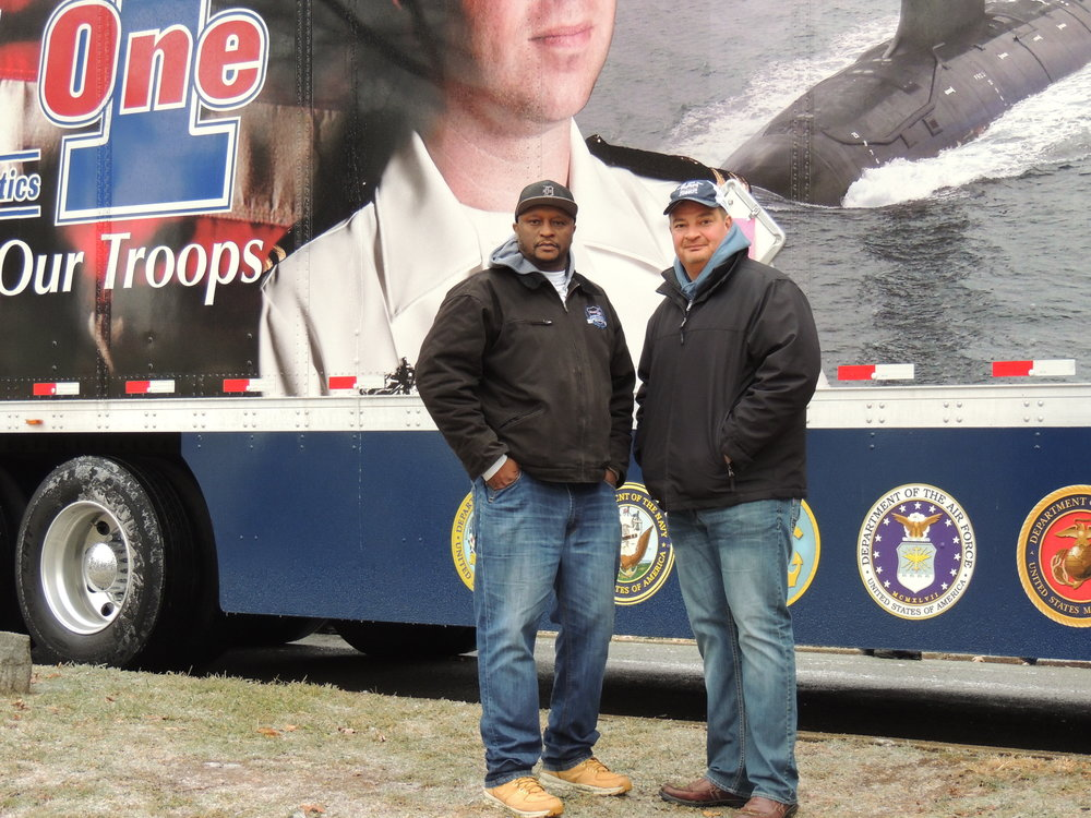 John Elliott (right) with Load One LLC seen here in Arlington National Cemetery in 2016 with fellow veteran and driver Torrey Alexander.