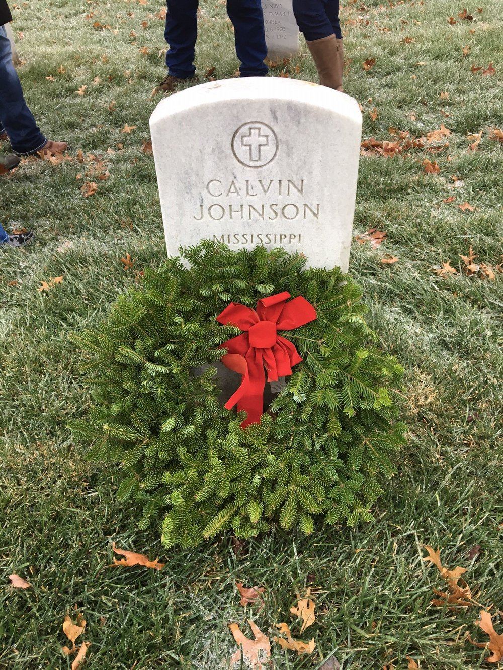 "Wade Gunter places a wreath and then takes a picture of ""his veteran"" back to work with him as a daily reminder of the sacrifice."