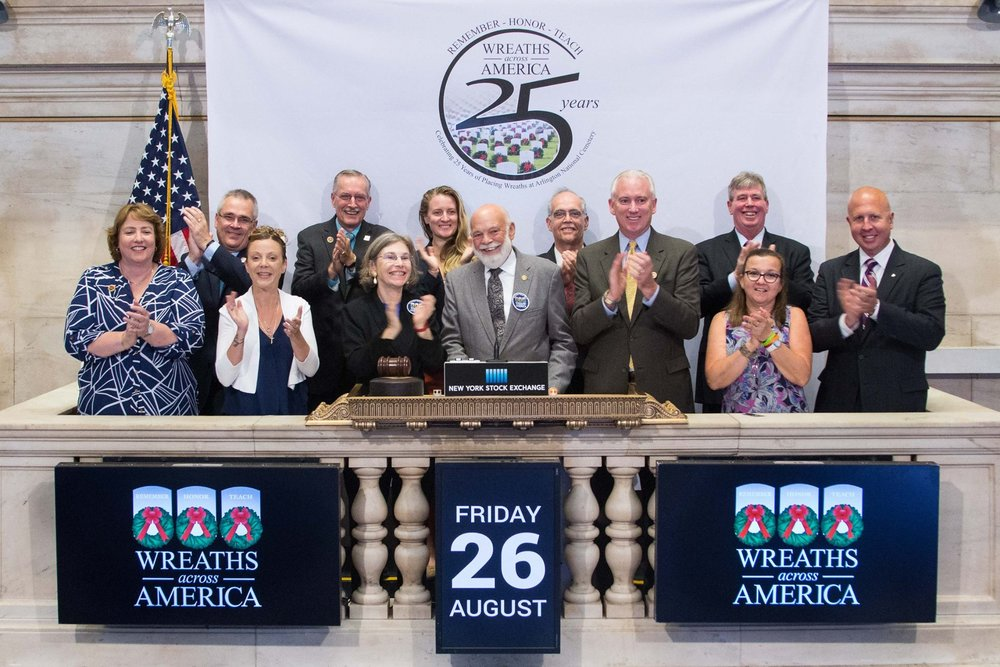 Wreaths Across America volunteers Ellen Fuller and Mel Russen (3rd and 4th in line from L-R, bottom row) are joined by some of Mel's Masonic brothers and their wives to ring the closing bell on the NYSE in 2016.