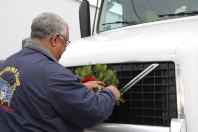 Calvin Waters, a first-time honor fleet driver with Perdue fastens a wreath to his truck as he prepared last week to transport his truckload of respect to the Naval Academy Cemetery in Annapolis, MD.
