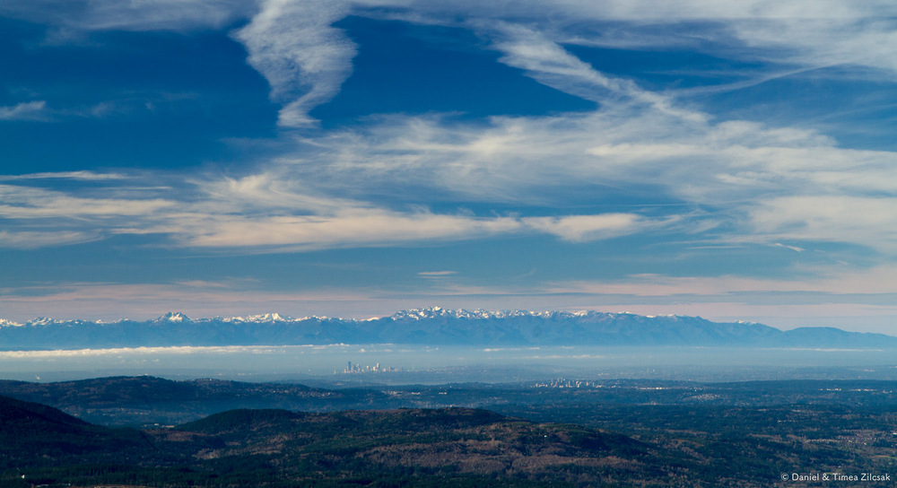 View from the top of Mount Si: The Olympic Mountain Range, and the cities of Seattle and Bellevue in the distance