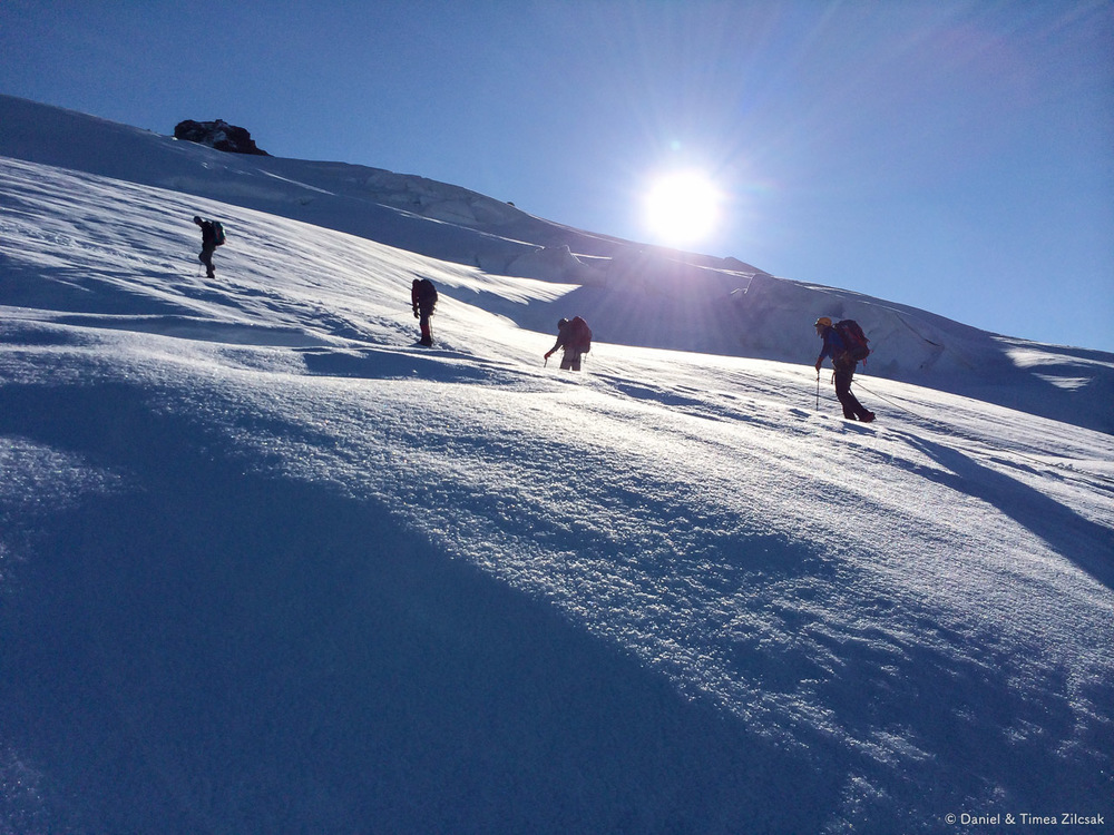 Climbing Mt Baker - Team crossing a crevasse