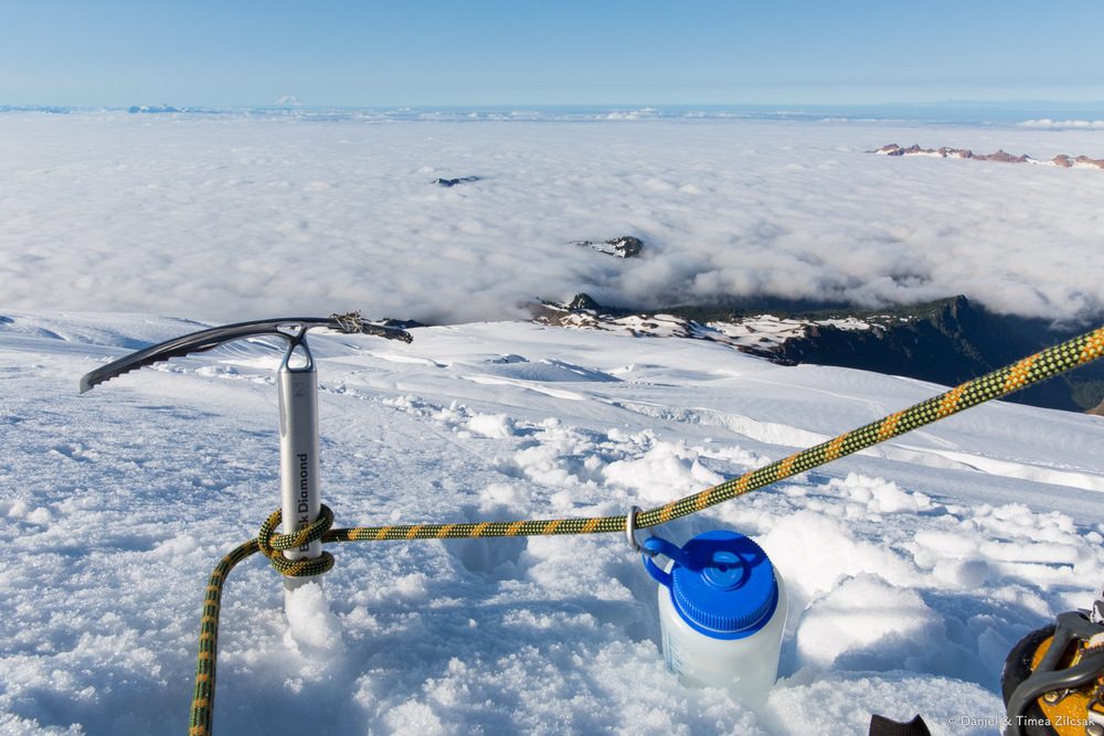 Climbing Mt Baker - Awesome view above the clouds from upper Easton Glacier. Mount Rainier is visible in the distance.