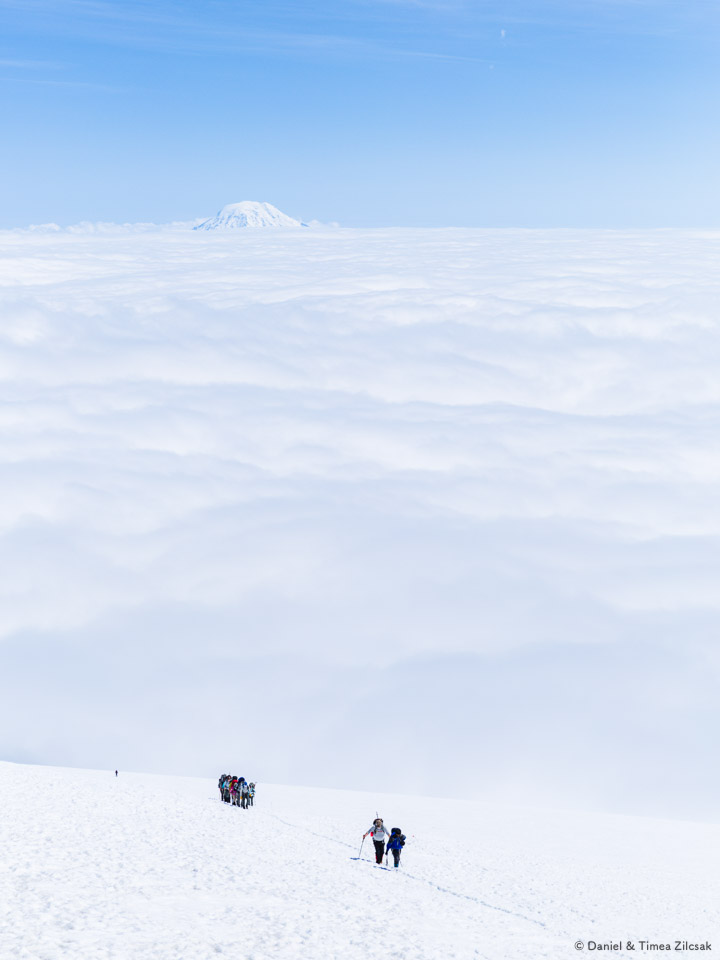 Climbing teams reaching Camp Muir, for a break before they Mount Rainier summit attempt