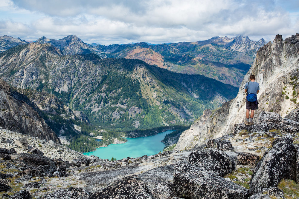 View of Colchuck Lake and mountains around it from the top of 7600 ft. Aasgard Pass, The Enchantments