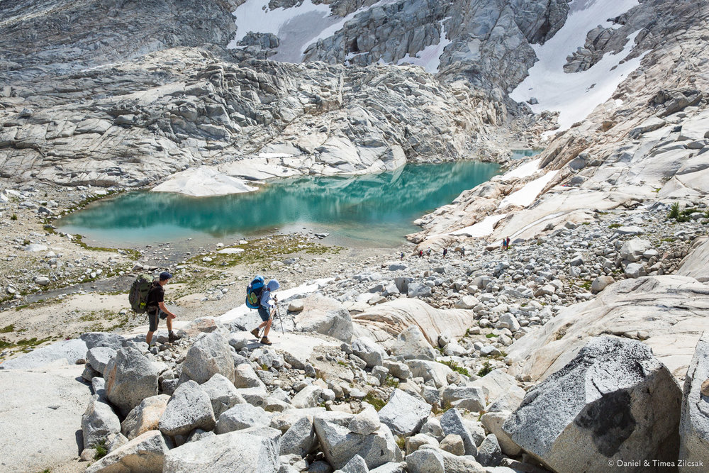 Backpacking the upper core Enchantments, hikers on trail near an alpine glacial lake- 9Z4A2810 © Zilcsak.jpg