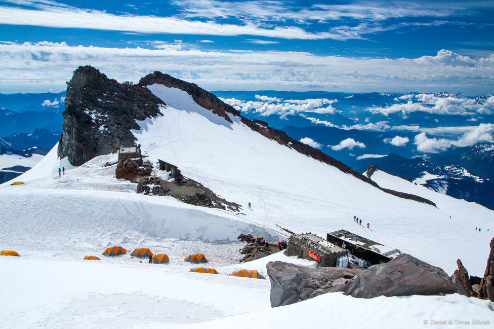 View of Camp Muir from above, including climbers' tents, guides' huts, and the public shelter