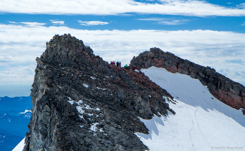 Camp Muir: climbers practicing mountaineering skills on the steeper slope below