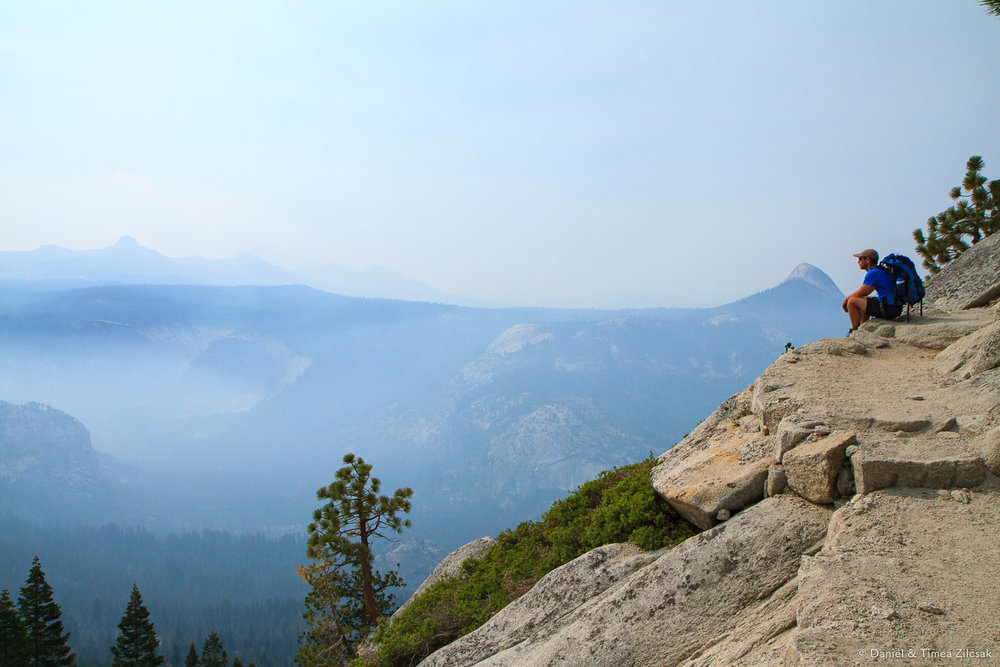 Taking a break on Sub Dome to enjoy the smoky Yosemite views