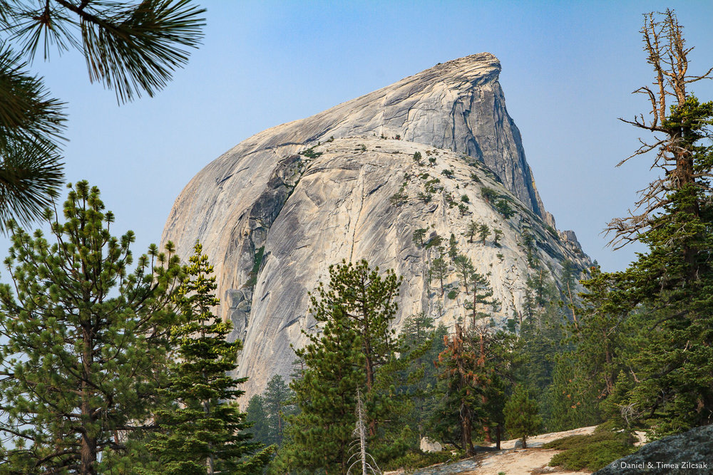 Sub Dome and Half Dome behind it. Zoom in to see folks looking for a better view.