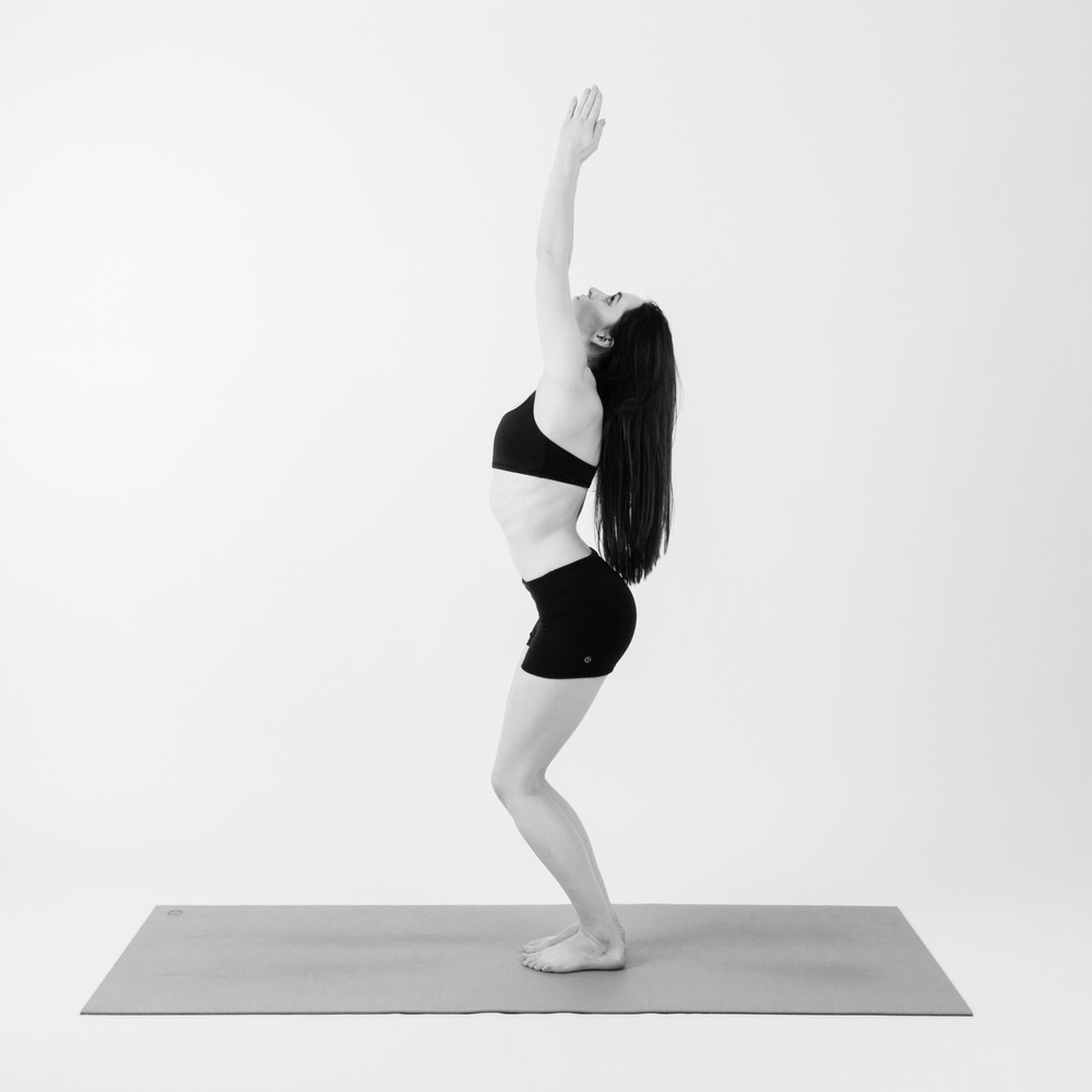 ARMS RAISED POSE      On your next inhale, rise all the way up to standing and reach your arms out around and up as you look up at your fingers. You may even reach slightly back behind you as you press your hips forward for a backbend
