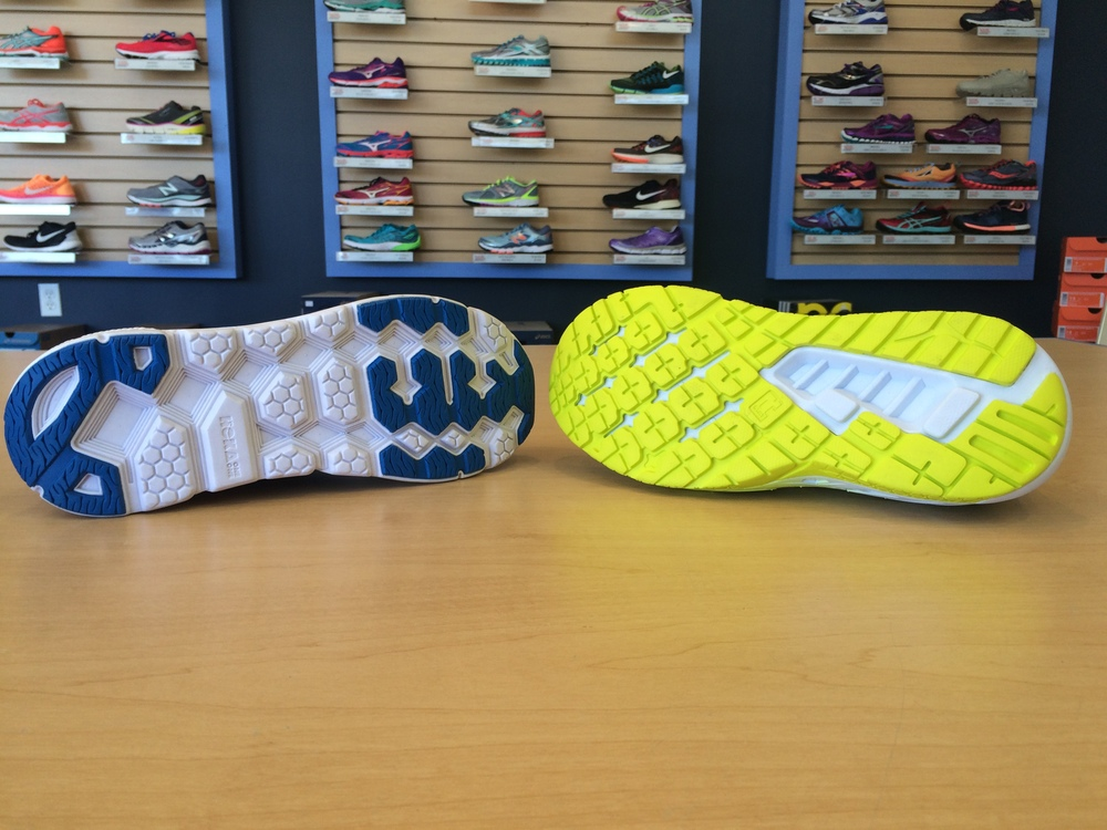 Left: Clifton 2 outsole with rubber pods, Right: Clayton outsole with full-length RMAT.