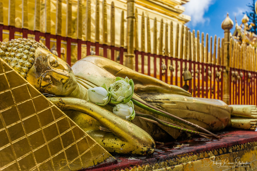 Golden Reclining Buddha with Lotus Flowers