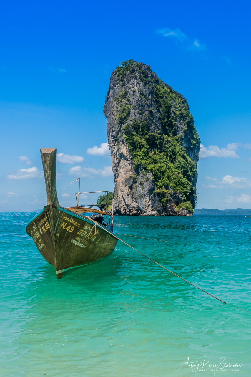 Longtail Boat and Karst Formation near Krabi, Thailand