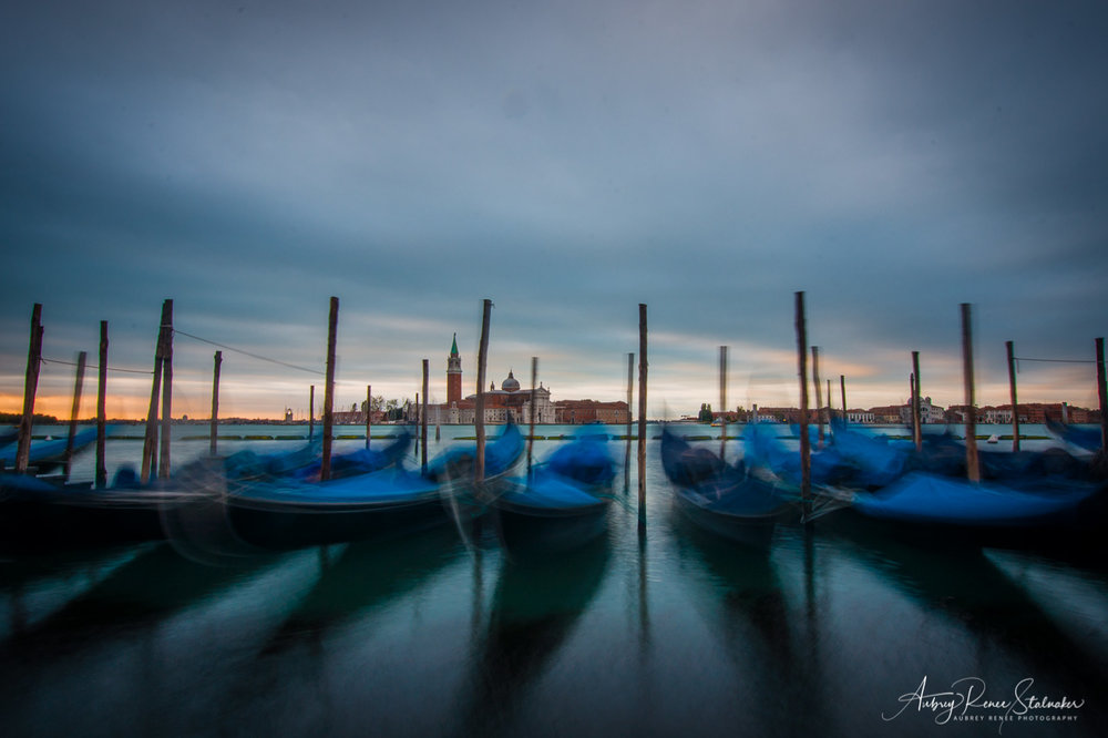 Gondolas at Sunrise on a Windy Morning near Piazza San Marco in Venice, Italy