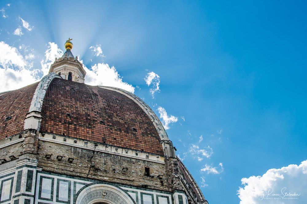 Sunburst behind the Duomo of Florence, Italy