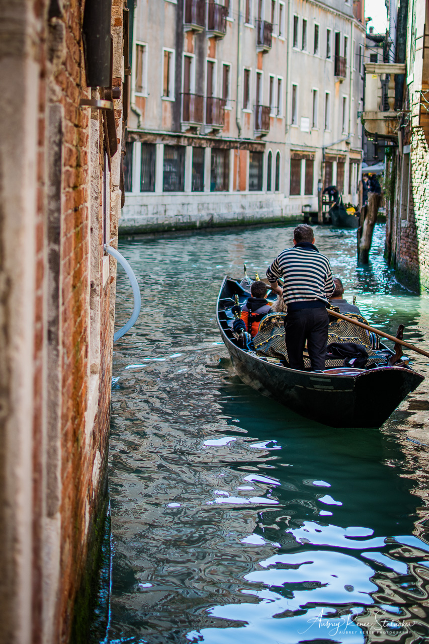 Gondolier on the Canals of Venice, Italy