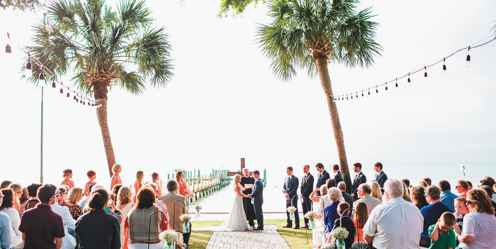 An intimate group of family and friends gathered in Destin to watch Judge Don Ash marry Kelli Lee Rollins & Devin Dillard. Photography by Brett Birdsong of Birdsong Photography