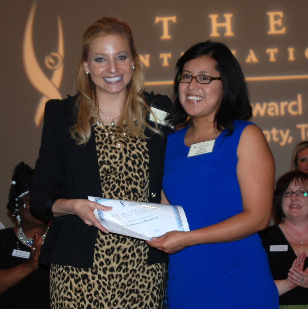 Naomi Bustamante receiving the 2015 ATHENA scholarship from Patrons Chair Rachel White.