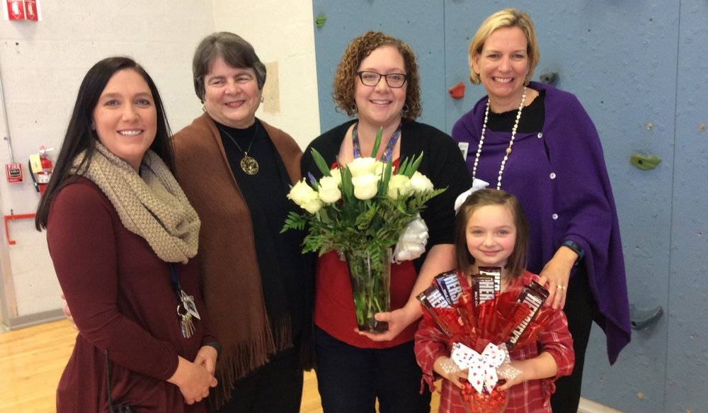 Dr. Tammy Garrett, Principal; Dr. Linda Gilbert, Director of Schools; Meredith Gilliland, District Teacher of the Year; her daughter Addie Gilliland; and Collier Smith, School Board Member