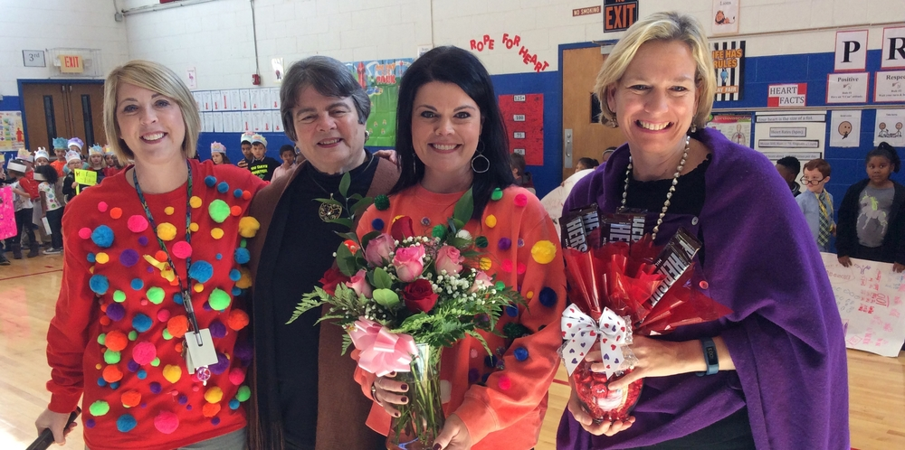 Laurie Offutt, Principal; Dr. Linda Gilbert, Director of Schools; Julie Parrish, District Teacher of the Year; and Collier Smith, School Board Member