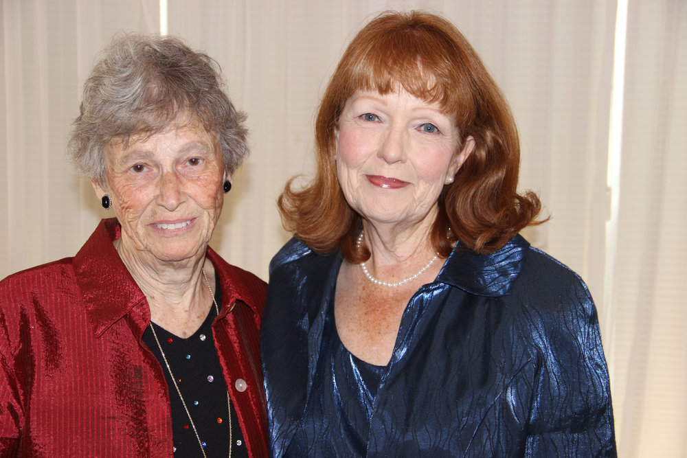 Joyce Moorehead (right) thanks Joan McVicker for preserving the history of the Little Gardens Club.