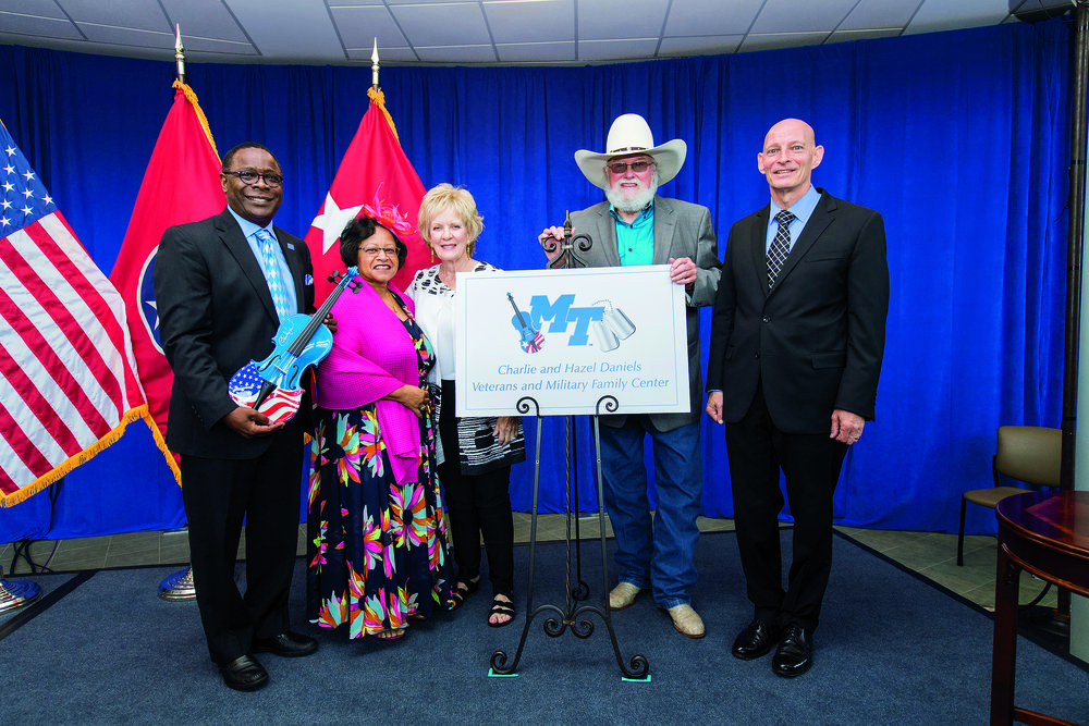 MTSU President Sidney A. McPhee and his wife Liz, along with Lt. Gen. Keith Huber (right), thank Hazel and Charlie Daniels for their commitment to the Charlie and Hazel Daniels Veterans and Military Family Center. MTSU Creative and Visual Services Photo by Andy Heidt