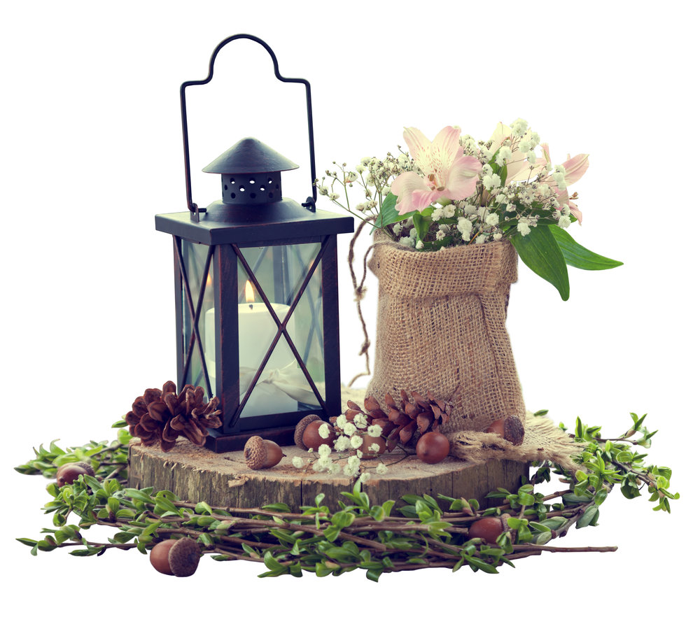Centerpieces can be rustic and elegant with burlap, wood and candlelight touches. Murfreesboro Flower Shop www.murfreesboroflowershop.com