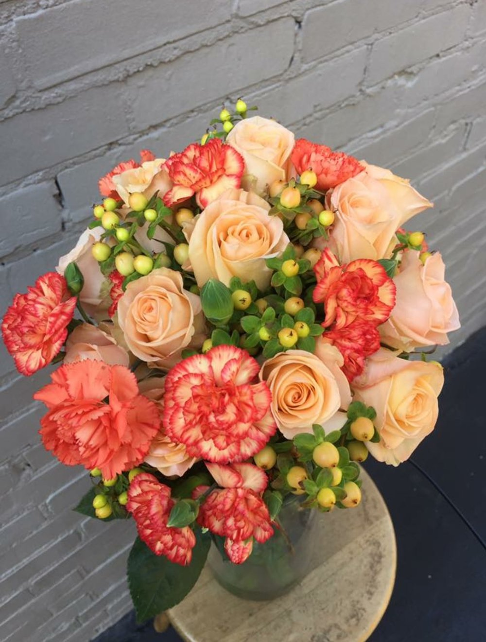 Clusters of soft peach flowers make a beautiful wedding bouquet. Rion Flowers and Gifts www.rionflowers.com