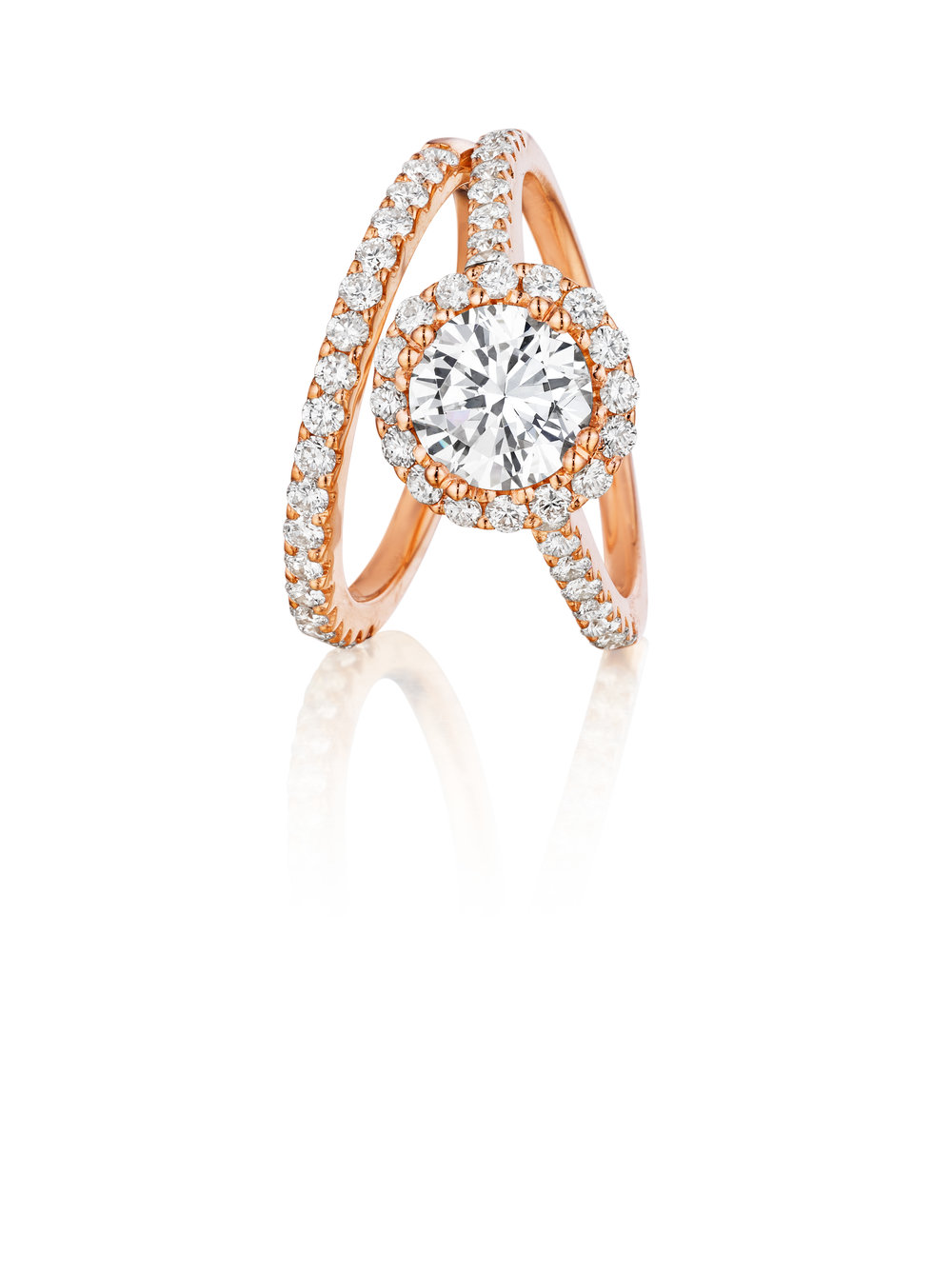 Even your wedding ring can have a rosy glow. This Gottlieb & Sons bridal set features almost 70 diamond of .85 ctw set in 18k rose gold. Bell Jewelers www.belljeweler.com