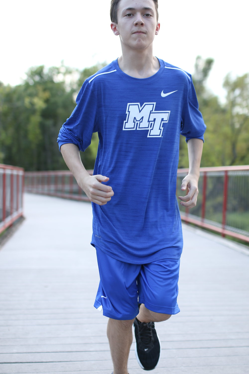 Will (Alumni Hall) Nike MT blue sleeveless running shirt and coordinating athletic shorts