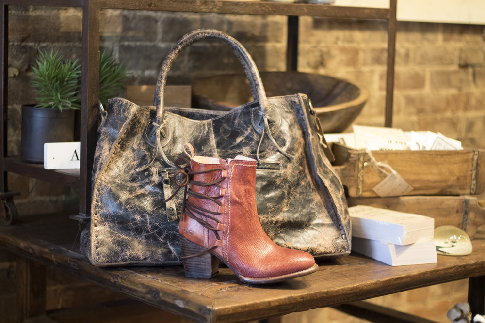 Trendy pieces carries an wide range of Bedstu hand crafted leather boots, shoes and bags. We carry this bootie style in red and black and the price is $229.99. The purse is a distressed leather and is priced at $299.99