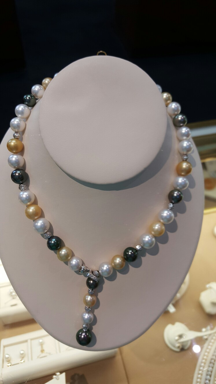 Make her every outfit classic with this one of a kind strand of pearls. These white south sea, golden and black Tahitian pearls with 18K white gold diamond clasp are sure to make her Christmas dreams come true! $6,495  Bell Jewelers 821 NW Broad Street