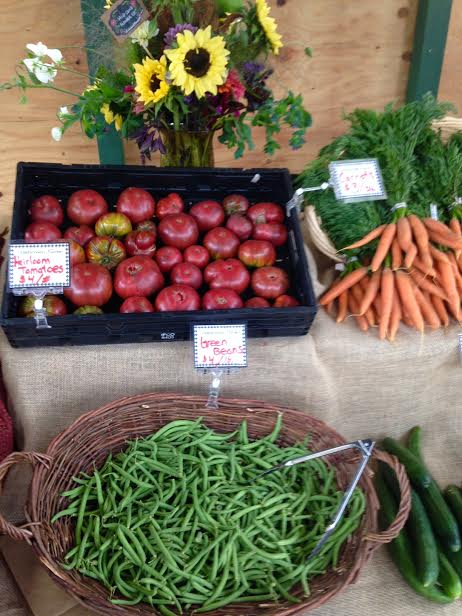 Saturday's farmstand with a Wild Child Flower Company bouquet