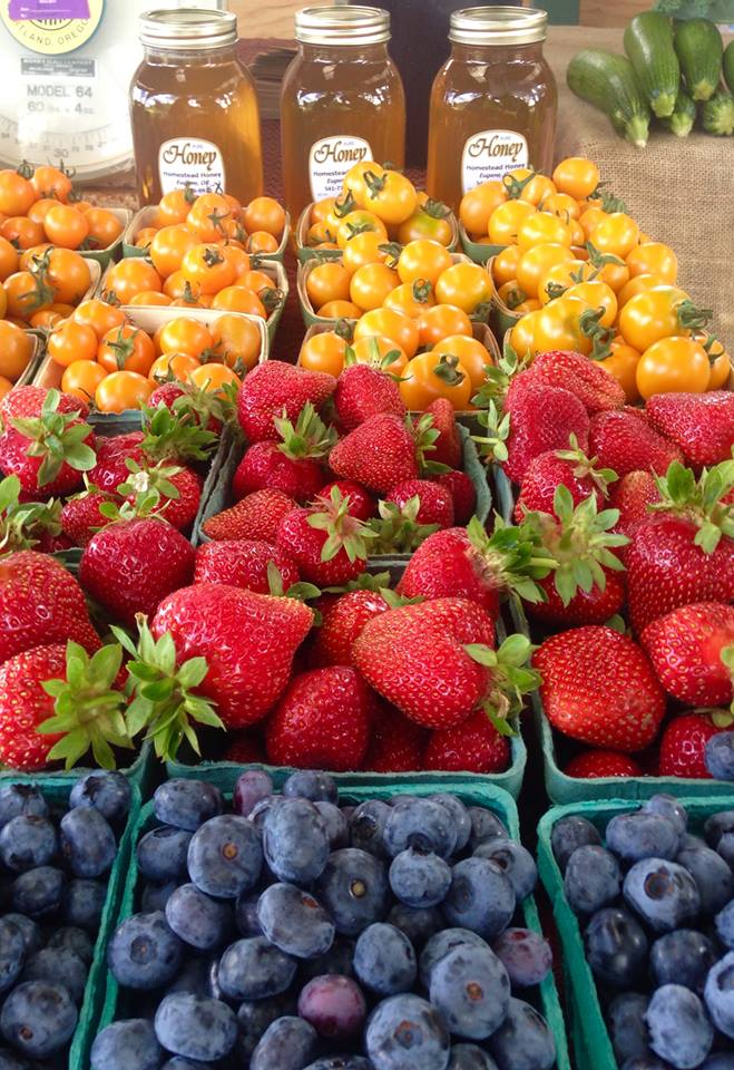 Rainbow of colors coming to light during a July market. Welcome to local and seasonal produce.