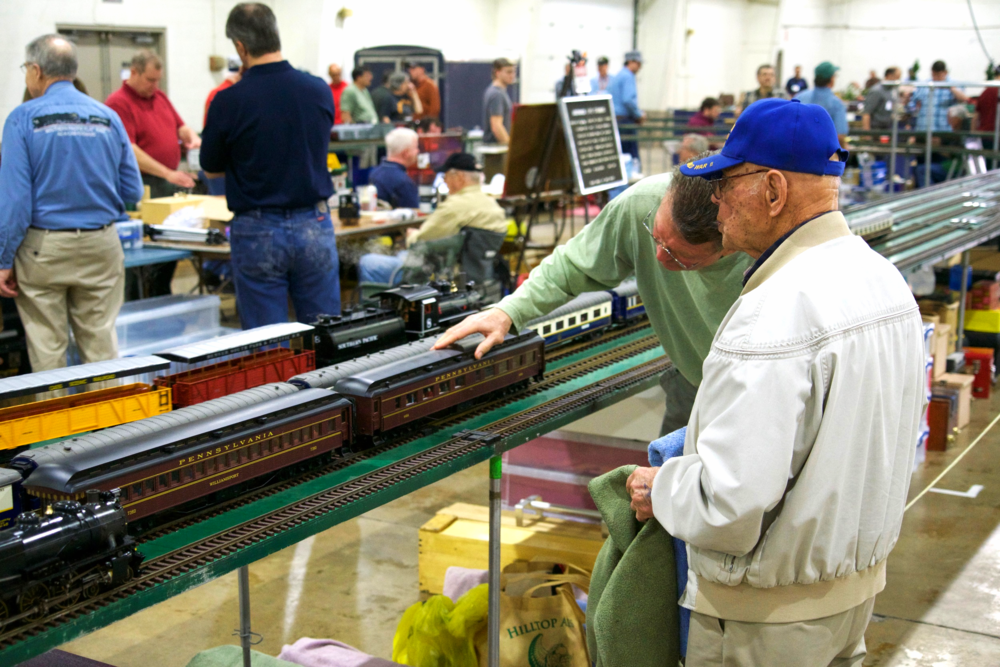 Father and son working on the Pennsylvania Railroad at the Live Steam Layout.