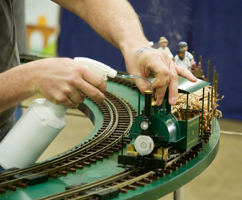 Topping up the water tank of a live steam model.