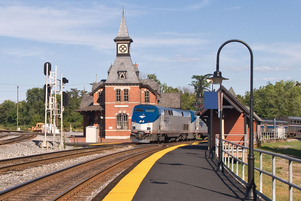 """Point of Rocks in Maryland. The CSX main line trackage from Chicago splits here: On the left is the line to Baltimore, while then tracks on the right go to Washington, DC. This is Amtrak's """"Capitol Limited"""" heading west bound towards Chicago. Photo By Samual Ruaat"""