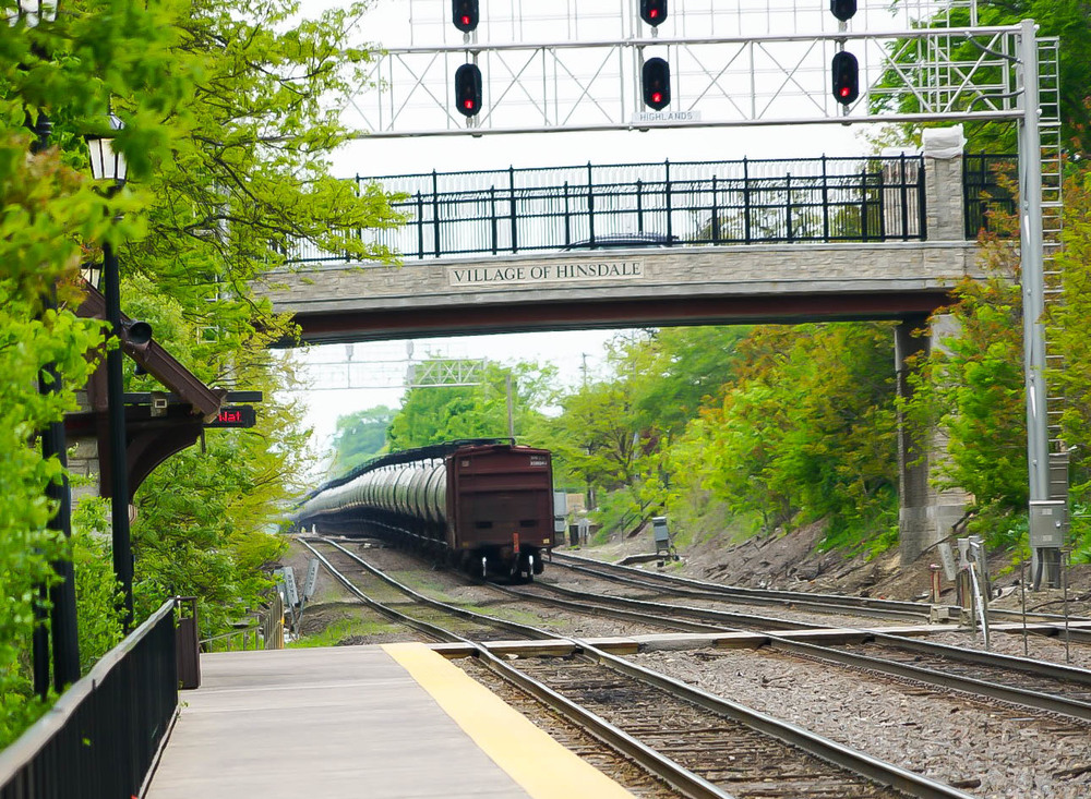 """The """"rear end""""of a Norfolk Southern Railroad unit oil train going through Hinsdale."""
