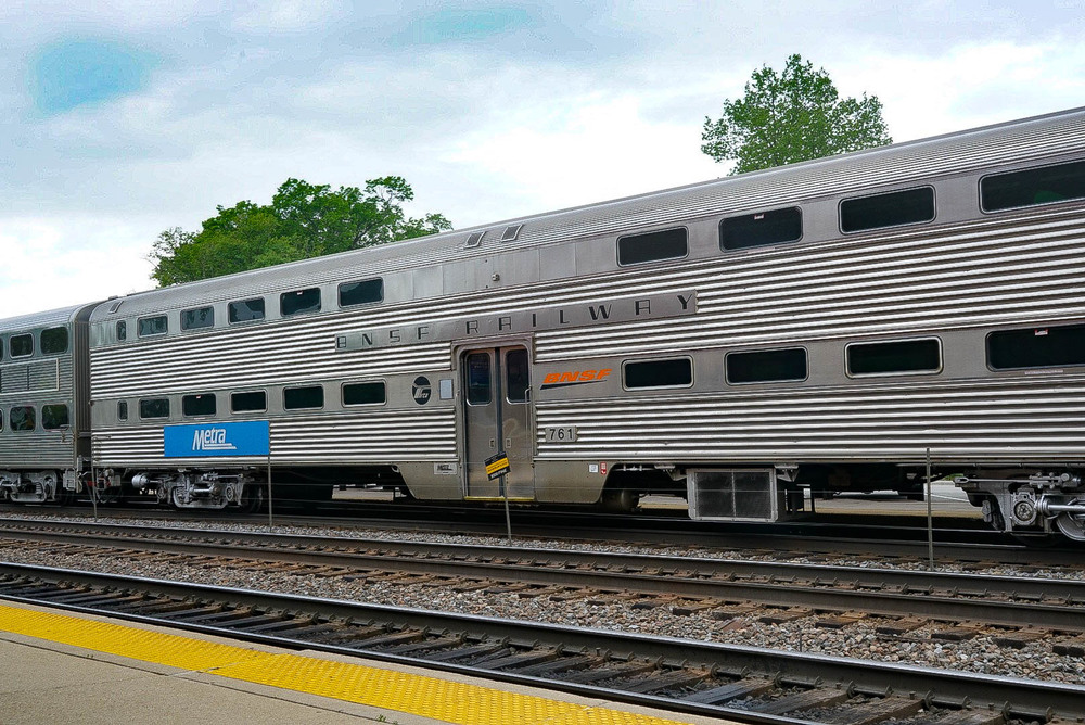 """Car 761 built by Budd in 1965 on a Metra """"Express"""" train going through Hinsdale station."""