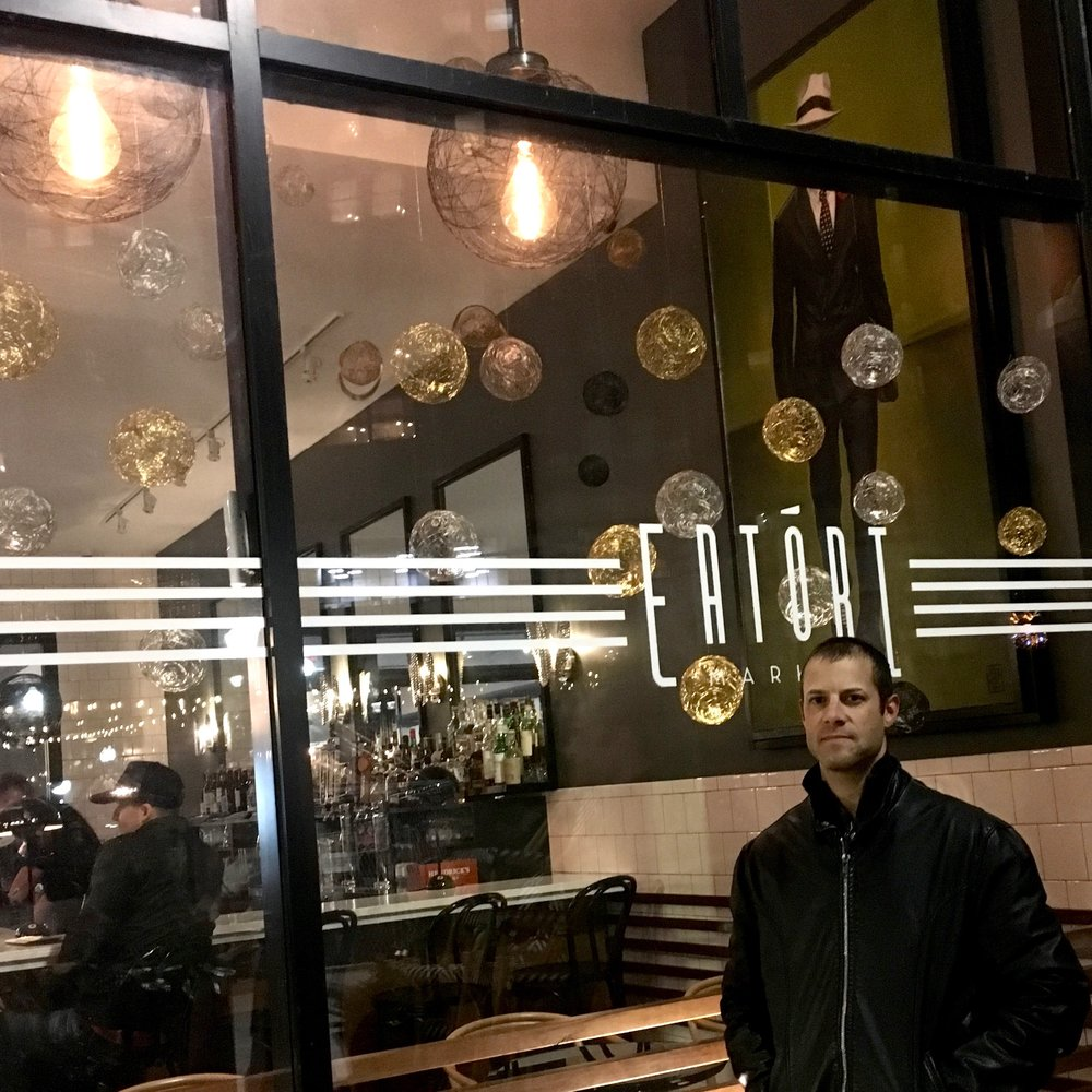 Mike O'Reilly stands in front of his 2018 Detroit Holiday Window Walk display, at Eatori Market.