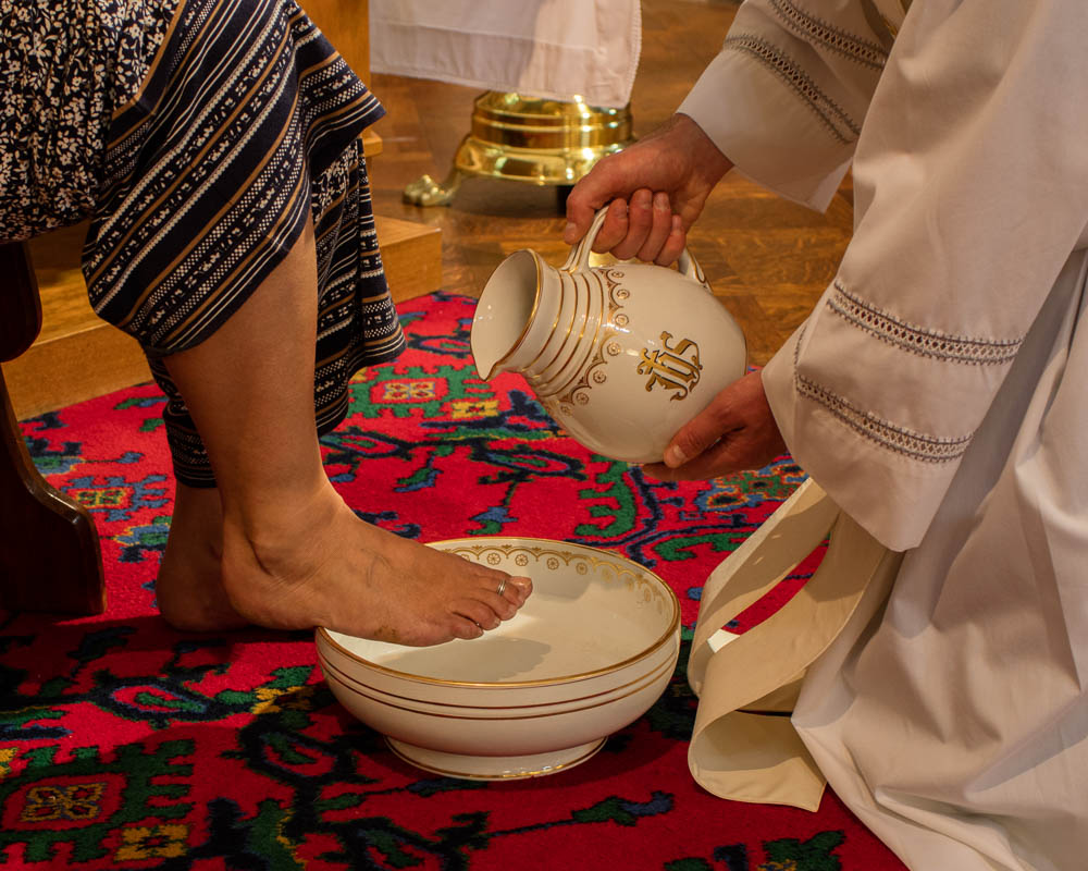 At the Mass of the Last Supper, Fr Philip followed Christ's example and washed the feet of twelve parishioners. In washing the feet of the disciples, Jesus gave us a new commandment, to love one another as he loved us.