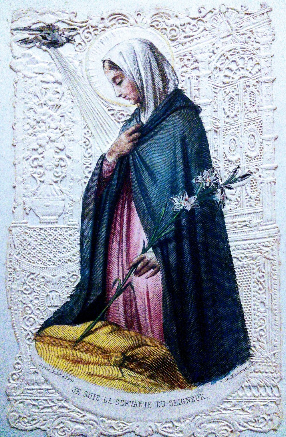 Lace prayer cards were very popular in nineteenth-century France, and beautifully made, and, like this one in Margaret Coulston's journal, hand-coloured. 'I am the servant of the Lord', the quotation reads.