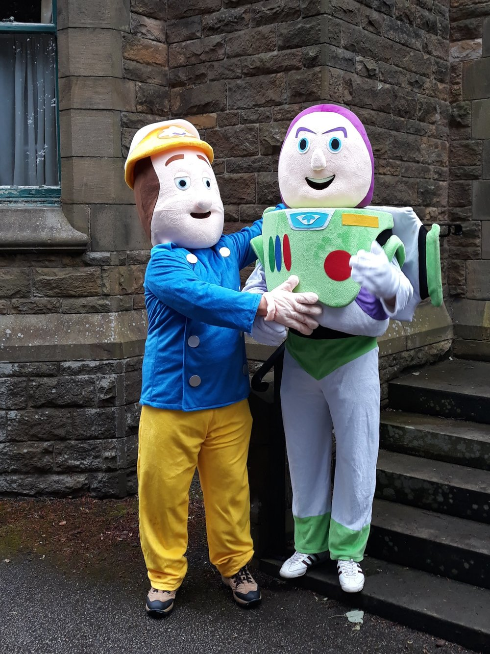 Enlisting the support of Buzz Lightyear and Fireman Sam for the parish fair and fundraising initiatives!