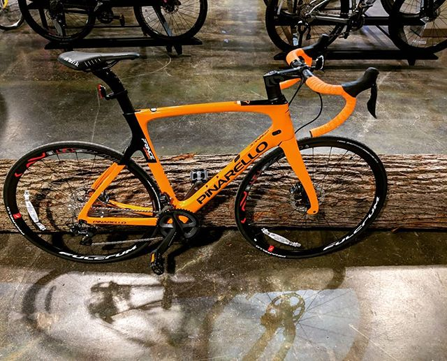 Just in is the new @pinarello_official Prince Disk! This bike is ready to take you on all your road endeavors! . . #pinarello #princedisk #roadbike #orange #timetoride