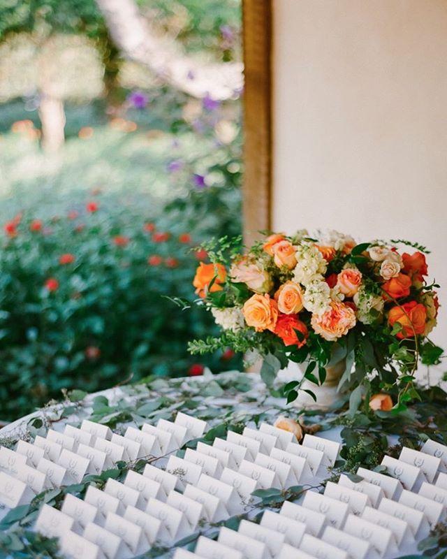 Jazz up your escort table with a vibrant flower arrangement! | Venue:@sanysidroranch | Planner: @simplynaturalevents | Photographers: @amyandstuart | Linens: @latavolalinen | #WisteriaLaneFlowers . . . . . #florist #weddingflorist #losangelesflorist #wedding #flowers #flowerstagram #weddinginspo #weddingdesign #designinspo #arrangement #blooms #weddingflowers #socalbride #socalflorist #losangelesflorist #theknot #theknotweddings #escorttable #summerflowers #summerarrangement #orangeflowers #escortcards