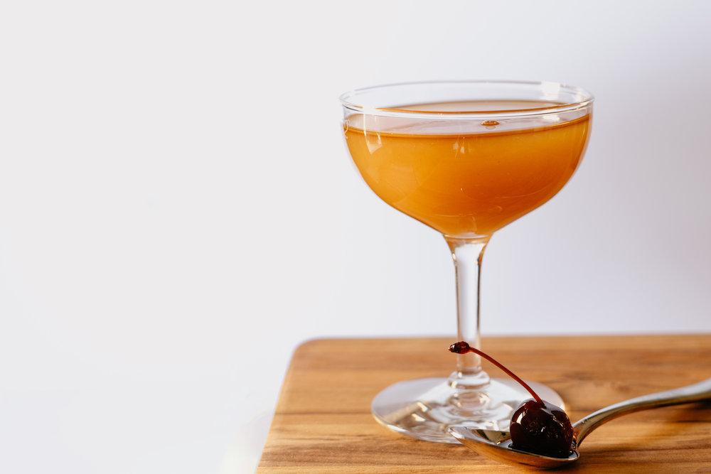 Coffee Whiskey Amaretto Sour - 1 oz coffee whiskey1 oz amaretto1 oz fresh orange juiceShake and strain. Serve with a cherry for garnish.