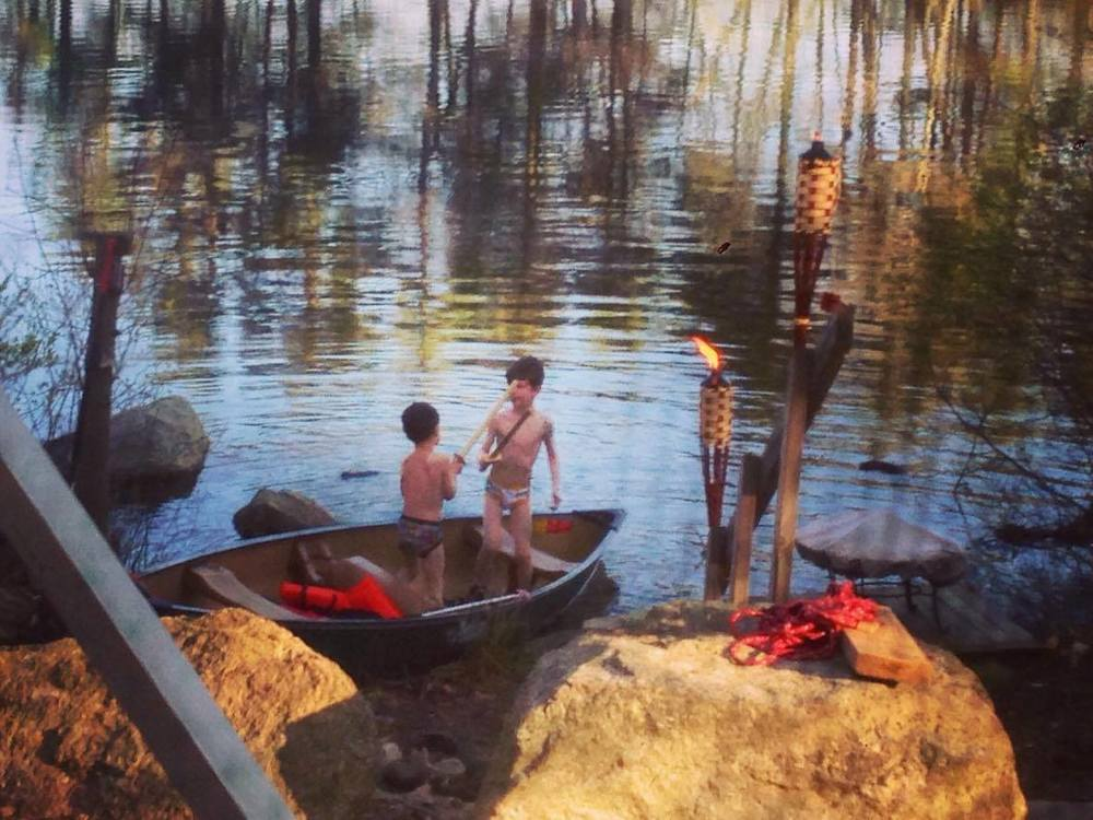 Who else can say they have a picture of their kids playing with wood swords in a canoe in their underwear?